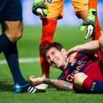 BARCELONA, SPAIN - SEPTEMBER 26:  Lionel Messi of FC Barcelona lays injured during the La Liga match between FC Barcelona and UD Las Palmas at Camp Nou on September 26, 2015 in Barcelona, Spain.  (Photo by Alex Caparros/Getty Images)