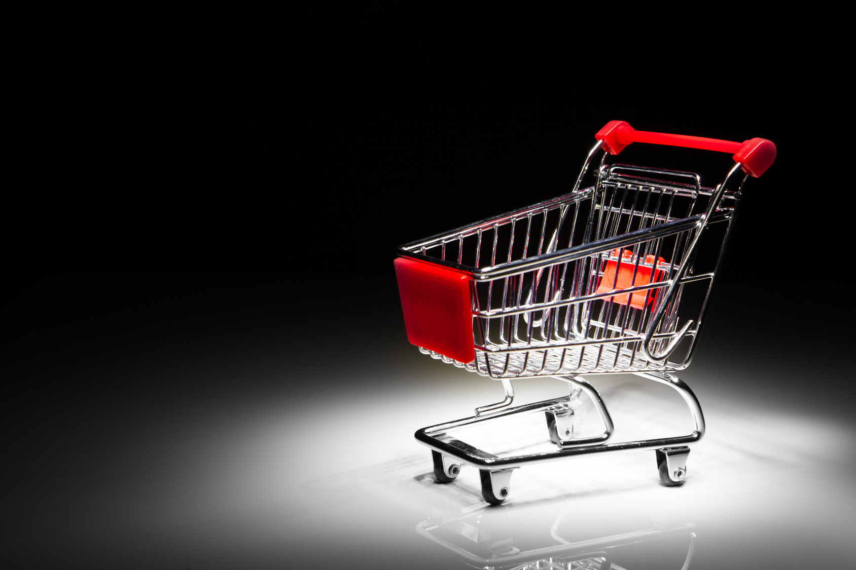 shopping cart on black background with copy-space